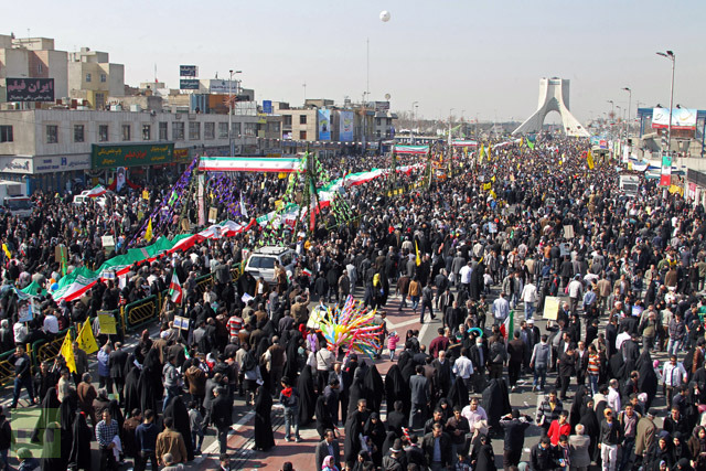 """Iranians attend a rally in Tehran's Azadi Square (Freedom Square) to mark the 34th anniversary of the Islamic revolution on February 10, 2013. Hundreds of thousands of people marched in Tehran and other cities chanting """"Death to America"""" and """"Death to Israel"""" as Iran celebrated the anniversary of the ousting of the US-backed shah. AFP PHOTO / ATTA KENARE"""